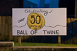 Sign noting celebration otf the 50 years of the world's largest ball of twine in downtown Cawker, Kans. along US 24.