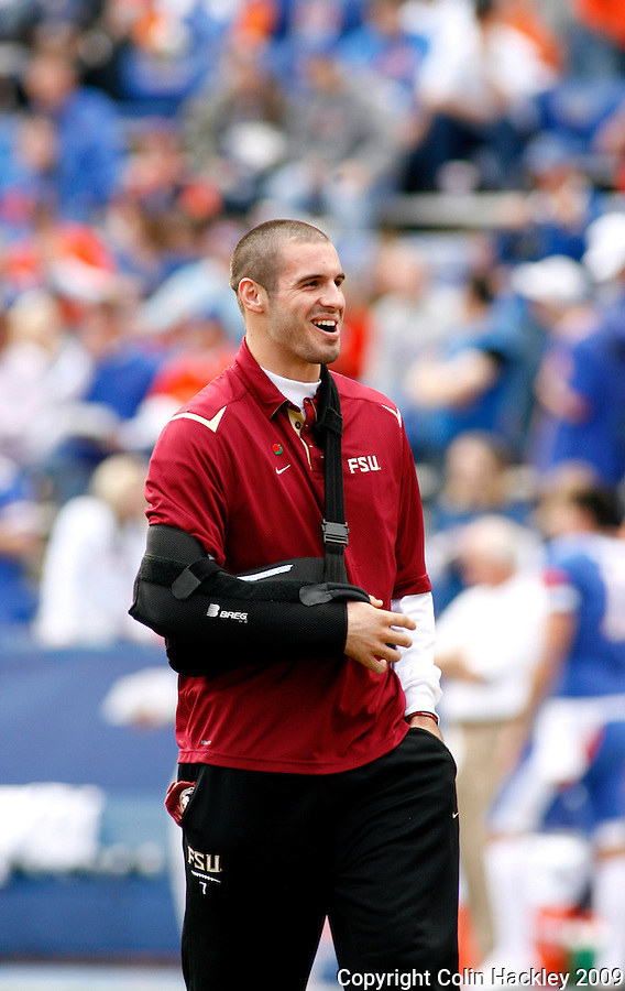 GAINESVILLE, FL 11/28/09-FSU-UF FB09 CH74-Florida State quarterback Christian Ponder watches the Seminoles warm up prior to the Florida game Saturday at Florida Field in Gainesville. Ponder underwent shoulder surgery recently and is expected to be ready for the 2010 season..COLIN HACKLEY PHOTO