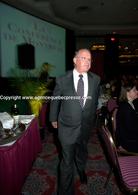 Montreal, April 18, 2001<br /> Quebec Premier ;  Bernard Landry get back to the head table after delivering his speech at the `` Conference of Montreal `` on economy globalization, Aptil 18, 2001 in Montreal, CANADA.<br /> Photo by Pierre Roussel / Liaison<br /> NOTE : Uncorrected Nikon D-1 JPEG saved as Adobe 1998 RGB color space.