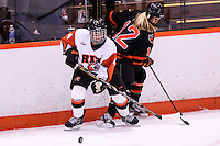 RIT's Kristina Moss (4) and Princeton's Kristina Moss (12) battle for the puck in the first period at Ritter Arena in Rochester, New York on October 19, 2012