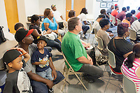 Copyright Justin Cook | July 24, 2013 - FROM LEFT: Tybious Streets, 5, his father Derrick Williams and other son Isaiah Williams, 4, (ALL CQ) during a criminal record expungement and certificate of relief clinic at the H. Leslie Perry Memorial Library in Henderson, NC.<br /> <br /> Derrick Williams, 37, a father of three, has a felony marijuana possession conviction from 1997 when he was 19 years old that he wants expunged from his record.