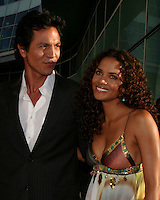 "©2004 KATHY HUTCHINS /HUTCHINS PHOTO.PREMIERE OF ""CATWOMAN"".HOLLYWOOD, CA.JULY 19, 2004..TALISA SOTO.HALLE BERRY.BENJAMIN BRATT"
