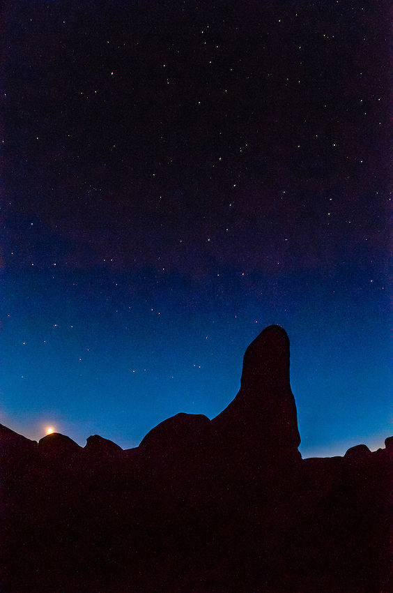 Rocks silhouetted my moonlight with a starry sky overhead, Goblin Valley State Park, Utah, USA.