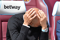 Manchester City manager Pep Guardiola holds his head during West Ham United vs Manchester City, Premier League Football at The London Stadium on 10th August 2019