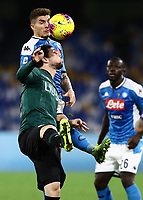 1st December 2019; Stadio San Paolo, Naples, Campania, Italy; Serie A Football, Napoli versus Bologna; Giovanni Di Lorenzo of Napoli wins the header to clear - Editorial Use