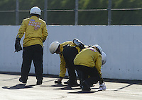Nov. 9, 2012; Pomona, CA, USA: NHRA safety safari cleans up oil on track during qualifying for the Auto Club Finals at at Auto Club Raceway at Pomona. Mandatory Credit: Mark J. Rebilas-