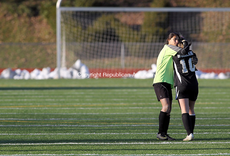 Watertown, CT-05 November 2011-110511CM10  Woodland keeper, Alma Rizvani (left) consoles teammate Keri Debiase after losing to Naugatuck,  in overtime penalty kicks.  Naugy will face Watertown for the NVL crown Tuesday night.   Christopher Massa Republican-American