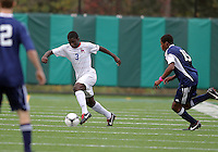 HYATTSVILLE, MD - OCTOBER 26, 2012:  William Kerr (3) of DeMatha Catholic High School moves the ball away from Azaan Wilbon (15) of St. Albans during a match at Heurich Field in Hyattsville, MD. on October 26. DeMatha won 2-0.