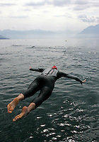 19 AUG 2005 - LAUSANNE, SWITZERLAND - A competitor practises her swimstart before the European Triathlon Championships. (PHOTO (C) NIGEL FARROW)