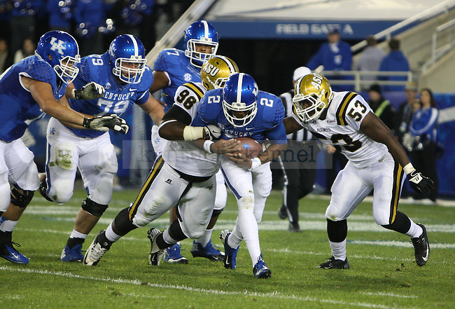 UK quarterback Jalen Whitlow (2) runs the ball forward against Alabama State defense during the University of Kentucky Homecoming football game against Alabama State at Commonwealth Stadium in Lexington, Ky., on Saturday, November 2, 2013. Photo by Tessa Lighty | Staff