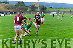 Dromids Dominic Ó Súilleabháin picks up a fumbled ball from Skellig Rangers Stephen O'Sullivan makes ground and passes to team mate Criostóir Ó Faircheallaigh who makes no mistake in putting it over the bar.