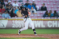 Salem-Keizer Volcanoes second baseman Kyle McPherson (2) swings at a pitch during a Northwest League game against the Eugene Emeralds at Volcanoes Stadium on August 31, 2018 in Keizer, Oregon. The Eugene Emeralds defeated the Salem-Keizer Volcanoes by a score of 7-3. (Zachary Lucy/Four Seam Images)