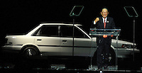 Toyota Motor Corporation Chairman Fujio Cho talks to the crowd during Toyota Motor Manufacturing Kentucky's 25th Anniversary celebration held at Rupp Arena. Cho appears with the 1989 #1 Toyota Camry.