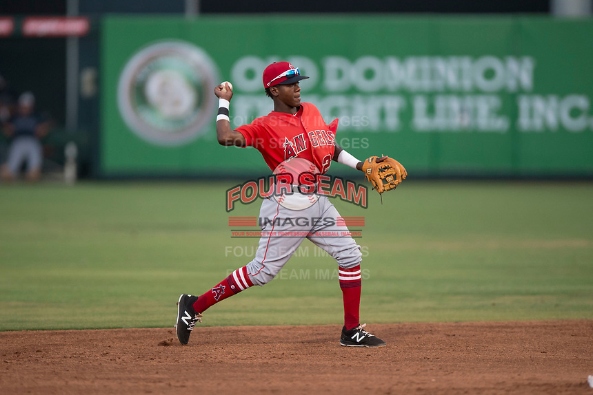 AZL Angels second baseman Daniel Ozoria (23) makes a throw to first base during an Arizona League game against the AZL Padres 2 at Tempe Diablo Stadium on July 18, 2018 in Tempe, Arizona. The AZL Padres 2 defeated the AZL Angels 8-1. (Zachary Lucy/Four Seam Images)