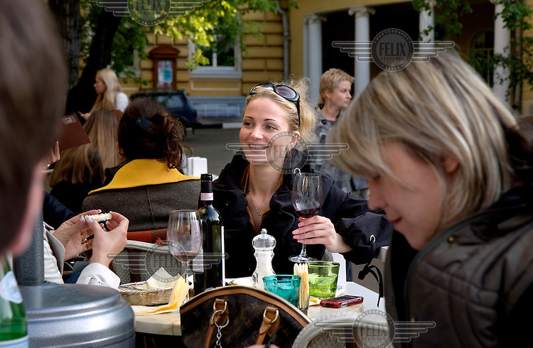 Middle-class Russians enjoy a glass of wine at the Coffee Mania cafe on Bolshaya Nikitskaya in Moscow.