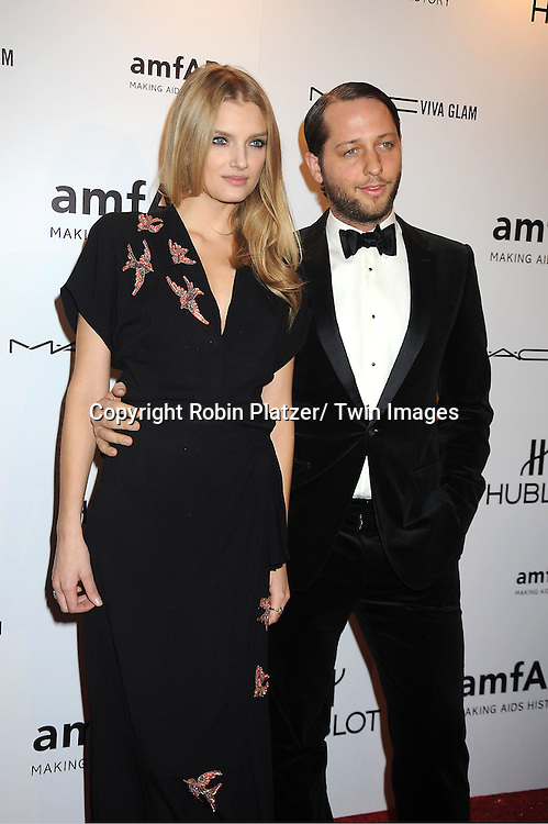Lily Donaldson and guest arrives at the amfAR New York Gala to kick off Fashion Week on February 8, 2012 at Cipriani Wall Street in New York City.
