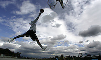 Baldwin Hills,Ca- Getting air while the getting is good. Maxwell Gilmore,13, enjoys a break in the weather, Sunday March 12, 2006 at Norma O Houston Park in Baldwin Hills. Sunday was partly cloudy with scattered showers. Monday forecast promises a bit more sunshine, chance of rain increases for Tuesday.