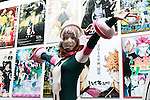An exhibitor dressed as an animation character poses for a photograph during the Anime Japan 2016 in Tokyo Big Sight on March 26, 2016, Tokyo, Japan. Anime Japan 2016 is the world's biggest exhibition promoting all aspects of the Anime industry to local and foreign fans and business investors. The exhibition is held over three days until March 27 and is expected to attract some 120,000 visitors, many wearing cosplay. (Photo by Rodrigo Reyes Marin/AFLO)