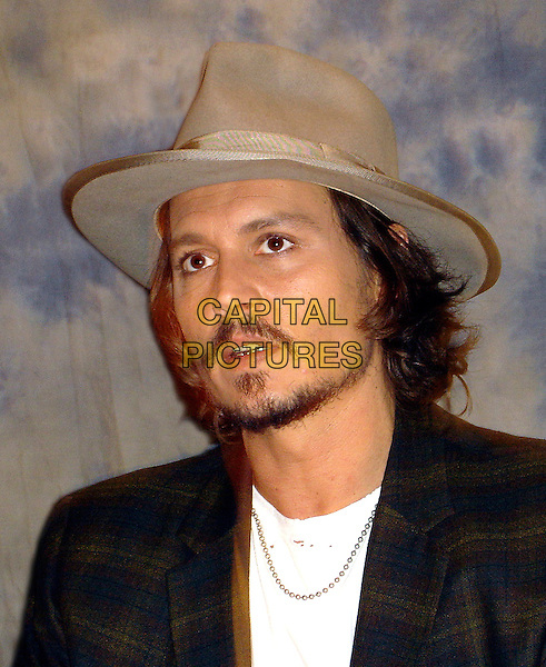 "JOHNNY DEPP.Press conference for ""Pirates of the Caribbean: Dead Man's Chest"" at the Regent Beverly Wilshire Hotel in Beverly Hills, USA..June 22nd, 2006.Ref: AW.headshot portrait hat goatee facial hair mustache.www.capitalpictures.com.sales@capitalpictures.com.© Capital Pictures."