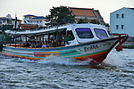 Tourists on a river boat trip on the Chao Phraya in Bangkok, Thailand
