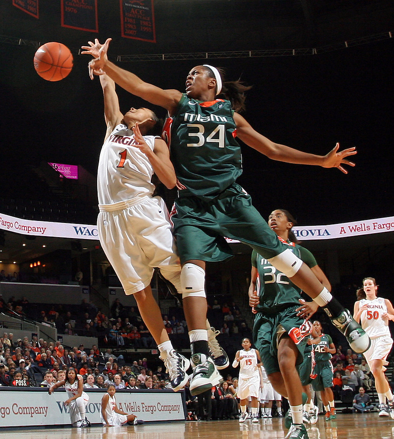 Jan. 6, 2011; Charlottesville, VA, USA; Miami Hurricanes forward Sylvia Bullock (34) fouls Virginia Cavaliers guard China Crosby (1) during the game at the John Paul Jones Arena. Miami won 82-73. Mandatory Credit: Andrew Shurleff