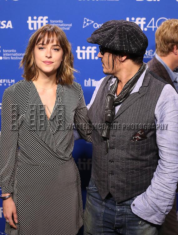 Dakota Johnson and Johnny Depp attend the 'Black Mass' photo call during the 2015 Toronto International Film Festival at Roy Thomson Hall on September 14, 2015 in Toronto, Canada.