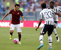 Calcio, Serie A: Roma vs Juventus. Roma, stadio Olimpico, 30 agosto 2015.<br /> Roma&rsquo;s Mohamed Salah, left, is challenged by Juventus&rsquo; Patrice Evra, second from left, and Paul Pogba, during the Italian Serie A football match between Roma and Juventus at Rome's Olympic stadium, 30 August 2015.<br /> UPDATE IMAGES PRESS/Riccardo De Luca