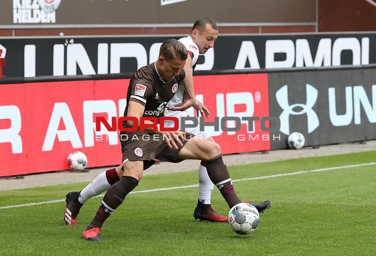nph00001  17.05.2020 --- Fussball --- Saison 2019 2020 --- 2. Fussball - Bundesliga --- 26. Spieltag: FC Sankt Pauli - 1. FC Nürnberg ---  DFL regulations prohibit any use of photographs as image sequences and/or quasi-video - Only for editorial use ! --- <br /> <br /> Leo Östigard Oestigard (3, FC St. Pauli ) Adam Zrelak (11, 1. FC Nürnberg ) <br /> <br /> Foto: Daniel Marr/Zink/Pool//via Kokenge/nordphoto