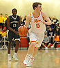 Robert Connors #15 of Chaminade dribbles downcourt during a CHSAA varsity boys basketball game against Holy Trinity at Chaminade High School in Mineola on Friday, Feb. 16, 2018. Chaminade won by a score of 79-61.