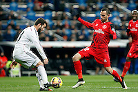 Nacho of Real Madrid and Alex Vidal of Sevilla during La Liga match between Real Madrid and Sevilla at Santiago Bernabeu Stadium in Madrid, Spain. February 04, 2015. (ALTERPHOTOS/Caro Marin) /NORTEphoto.com