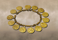 Bronze Age Hattian gold necklace from Grave E,  possibly a Bronze Age Royal grave (2500 BC to 2250 BC) - Alacahoyuk - Museum of Anatolian Civilisations, Ankara, Turkey. Against a warm art background