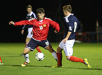 Lewis MacLeod and Vardan Bakalyan tackle in the Scotland v Armenia UEFA European Under-19 Championship Qualifying Round match at New Douglas Park, Hamilton on 9.10.12.