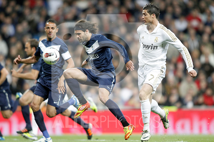 Real Madrid's Cristiano Ronaldo against Malaga's Sergio Sanchez and Robson Oliveira Weligton during La Liga Match. March 18, 2012. (ALTERPHOTOS/Alvaro Hernandez)