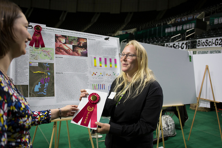 Charlene Hopkins receives a second place ribbon at the student expo on April 6, 2017.