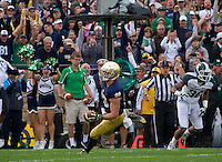 Running back Cam McDaniel (33) runs in for ND's second and final touchdown.