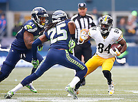 Antonio Brown #84 of the Pittsburgh Steelers runs with the ball in front of Richard Sherman #25 of the Seattle Seahawks in the first half during the game at CenturyLink Field on November 29, 2015 in Seattle, Washington. (Photo by Jared Wickerham/DKPittsburghSports)