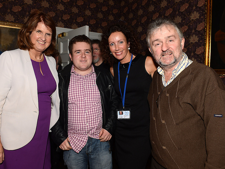 Eoghan O'Reilly and his dad Peter with Employment Facillatator Eimear Marron and Minister for Social Protection Joan Brutonat the launch of the Walk Peer Programme in Bellingham Castle hotel. Photo:Colin Bell/pressphotos.ie