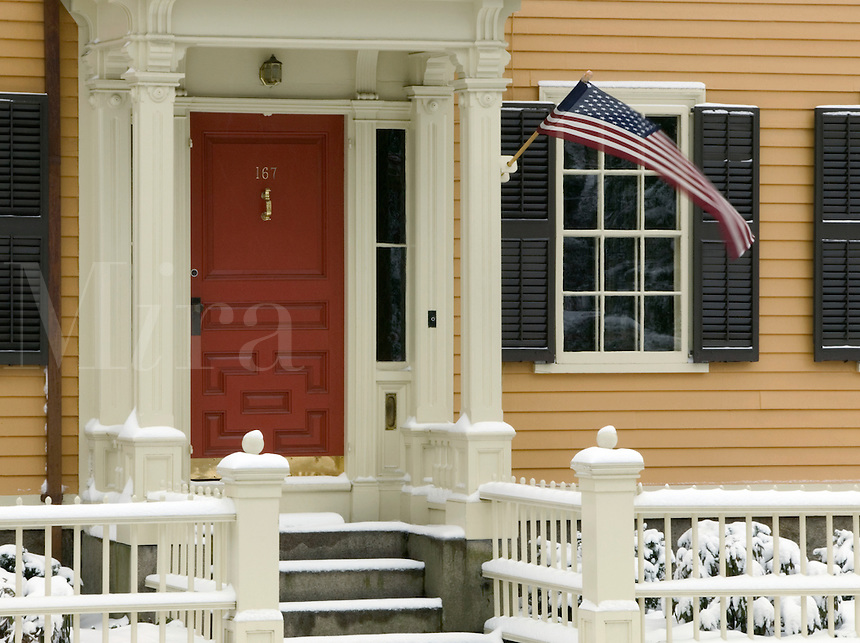 Architectural detail of historic house, American flag, snow. Providence, Rhode Island.