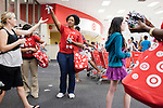 August 20, 2011. Chapel Hill, NC.. Tyshia Hedgspeth, a UNC student hired by Target, hands out freebies to other students brought from the UNC campus by Target chartered buses on campus move in day. The company staged sales to encourage students to buy items in the store that they might need for their dorm rooms.. Many companies have increased their efforts to reach the youth market by employing popular college students to raise the awareness of the brand by peer to peer marketing on campus' around the country.