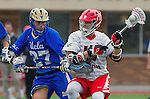 Orange, CA 03-05-17 - Blake Lee (Chapman #17) and Jordan Robertson (UCLA #27) in action during the UCLA - Champman Southern Lacrosse Conference MCLA Division 1 Men's Lacrosse game.