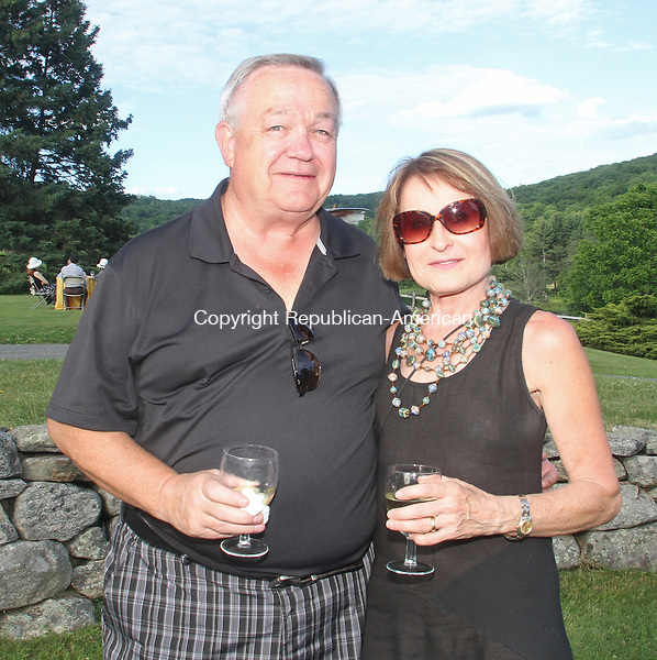 KENT, CT-062114MK34(from left)Ernie Schmutzler and Monika Nixon gathered at the Summer Solstice Soiree: Kent Memorial Library's Annual Fundraising Party at Iron Mountain Farm and Gardens. Michael Kabelka / Republican-American