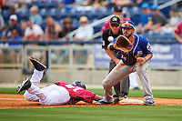 Biloxi Shuckers first baseman Nick Ramirez (14) stretches for a pickoff throw as Juan Silva (27) dives back during the first game of a double header against the Pensacola Blue Wahoos on April 26, 2015 at Pensacola Bayfront Stadium in Pensacola, Florida.  Biloxi defeated Pensacola 2-1.  (Mike Janes/Four Seam Images)