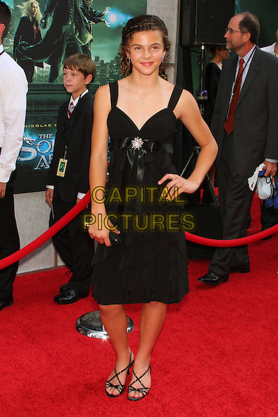 """NICOLE EHINGER .attending the World Premiere of """"The Sorcerer's Apprentice"""" at the New Amsterdam Theatre in Times Square,  New York, NY, USA, July 6th, 2010..full length black dress hand on hip sandals strappy .CAP/LNC/TOM.©TOM/LNC/Capital Pictures."""