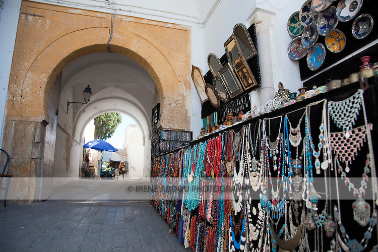 Necklaces and other Tunisian handicrafts for sale line the streets of Sidi Bou Said, a charming town near the Tunisian capital.