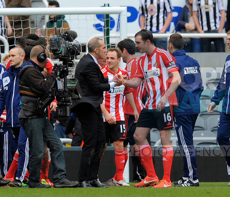 Sunderland manager Paolo Di Canio (C) congratulates John O'Shea of Sunderland at the end of the game - Barclays Premier League - Newcastle Utd vs Sunderland - St. James' Park - Newcastle - 14/04/13 - Picture Richard Lee/Sportimage