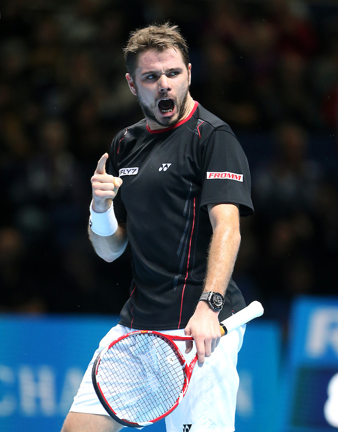 Stanislas Wawrinka of Switzerland celebrates winning a point during his game against David Ferrer of Spain<br /> <br /> Photo by Rob Newell/CameraSport<br /> <br /> International Tennis - Barclays ATP World Tour Finals - O2 Arena - London - Day 5 -  Fridday 8th November 2013<br /> <br /> &copy; CameraSport - 43 Linden Ave. Countesthorpe. Leicester. England. LE8 5PG - Tel: +44 (0) 116 277 4147 - admin@camerasport.com - www.camerasport.com