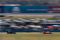 DAYTONA BEACH, FL - JAN 25: The #7 Acura DPi of Ricky Taylor, Helio Castroneves and Alexander Rossi, leads the #10 Cadillac DPi of Renger van der Zande, of the Netherlands, Ryan Briscoe, of Australia, Scott Dixon, of New Zealand, and Kamui Kobayashi, of Japan, during the Rolex 24 at Daytona at Daytona International Speedway, Daytona Beach, Florida,  January 25, 2020. (Photo by Brian Cleary/BCPix.com)