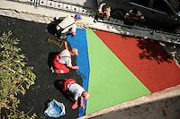 Turkish builders laying coloured bitumen for a children's playground in Istanbul, Turkey