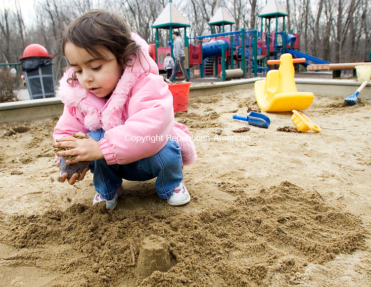 PROSPECT, CT- 13 MARCH 07- 031307JT03- <br /> Alana Torres, 3, of Prospect, builds sand castles at the playground at Hotchkiss Park in Prospect on Tuesday.<br /> Josalee Thrift Republican-American