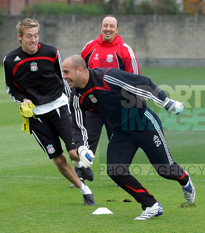 Liverpool Champions League Training, Melwood Training Complex, West Derby, Liverpool, 5th November 2007...Pepe Reina (R) is chased by team-mate Peter Crouch (L), all watched by manager Rafael Benitez.